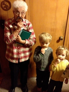 Grandma and the boys, sporting candy mustaches.